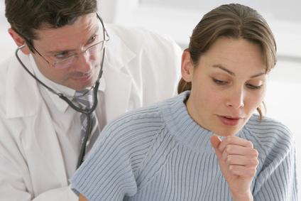 Lady Coughing and Doctor Monitoring Breathing