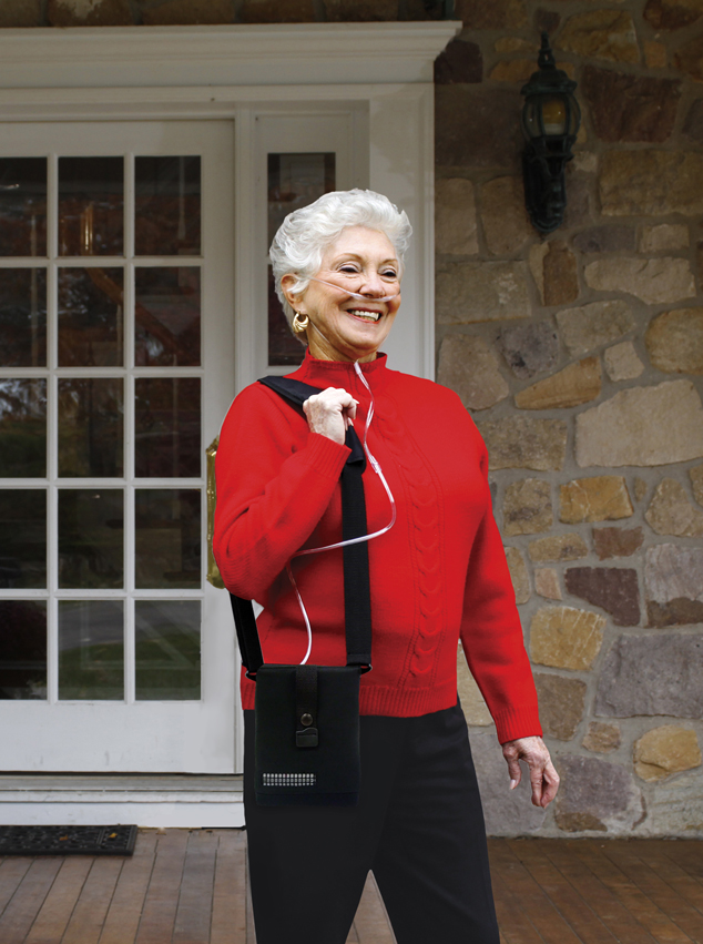 Lady in Red with Inogen One G4 Portable Oxygen Concentrator