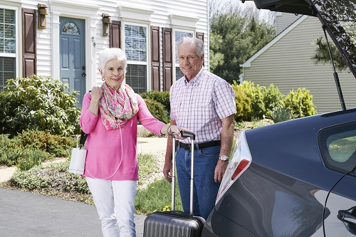 Couple with Inogen One G4 Portable Oxygen Concentrator Getting Ready for Car Trip