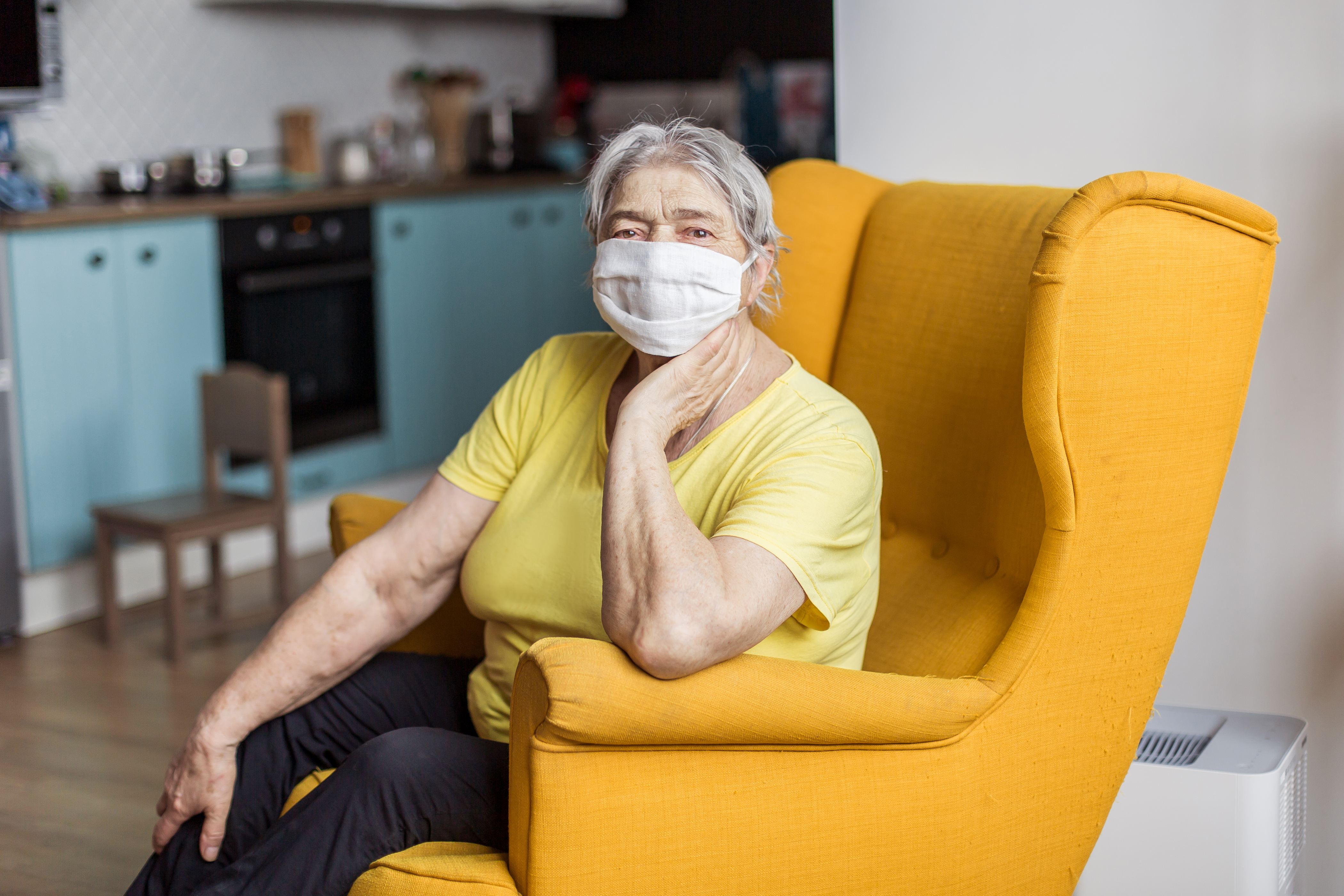 Woman with Facemask on Chair