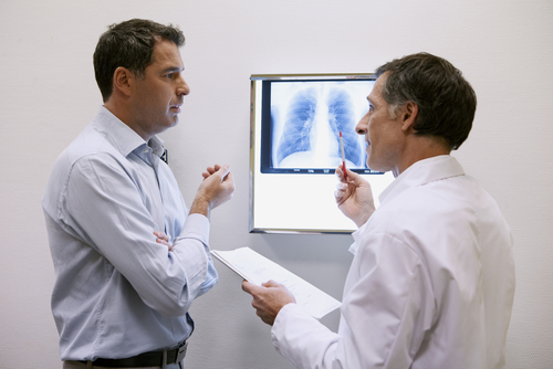 Doctor consulting patient about lung x-ray